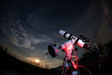 The Telescope Is Pointed At The Sky. The Rising Moon And Stars.