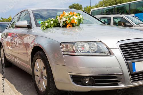 Wedding car. Car decoration for wedding with big bouquet.