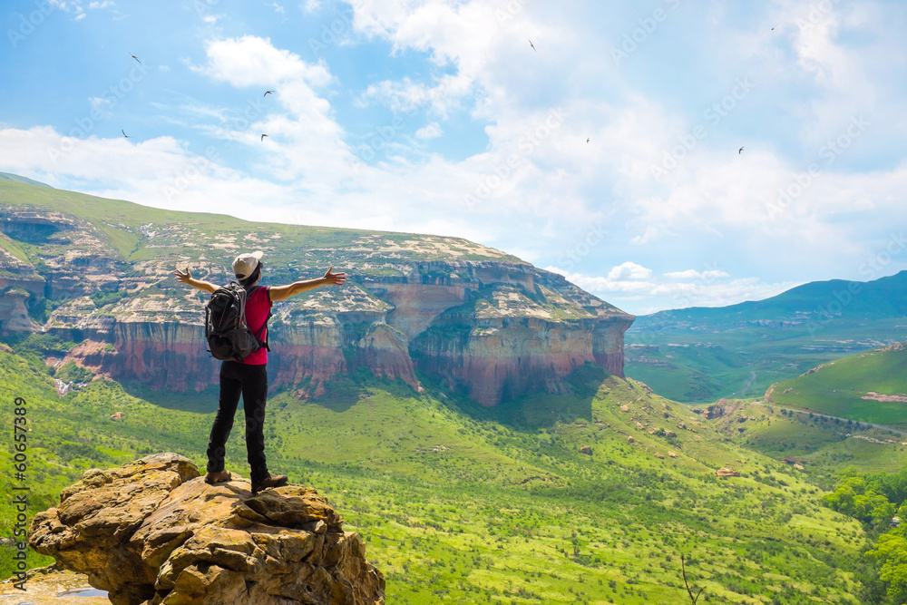Fototapety, obrazy: Tourist contemplating mountain view.