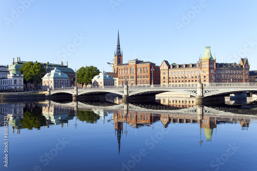Photo  Stockholm, Sweden. Embankment and its reflection in the water ea