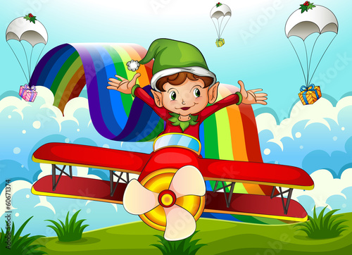 Papiers peints Avion, ballon A plane with an elf and a rainbow in the sky with parachutes