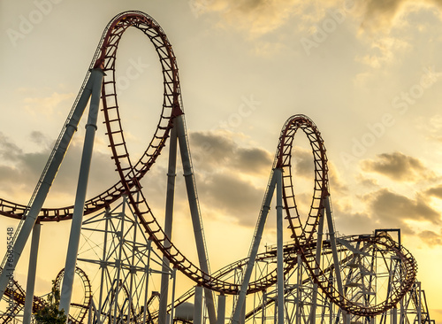 Staande foto Amusementspark Roller Coaster at Sunset