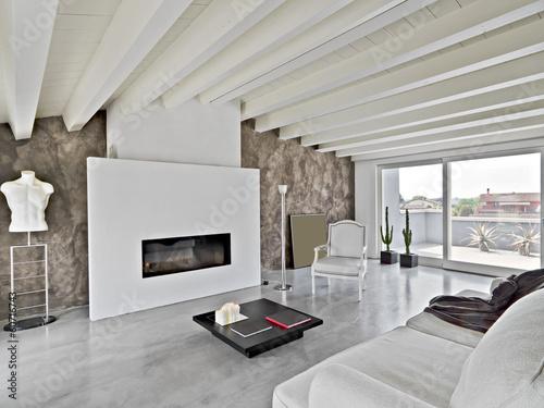 soggiorno moderno con camino in mansarda - Buy this stock photo and ...