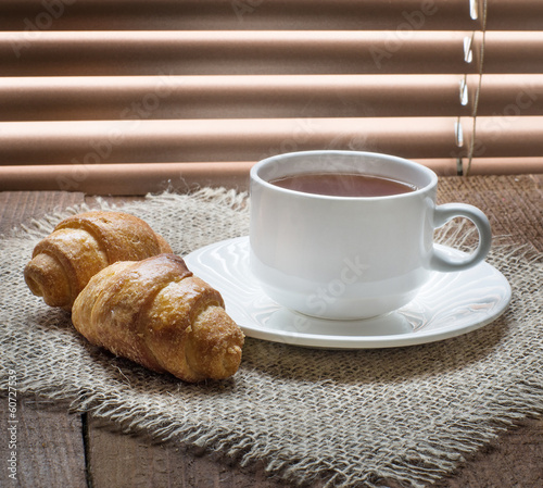 Photo Stands Coffee beans tea cup with teapot on old wooden table
