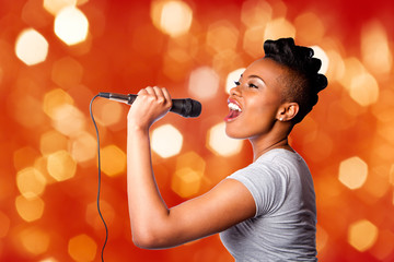 Fototapeta Singing kareoke woman with microphone