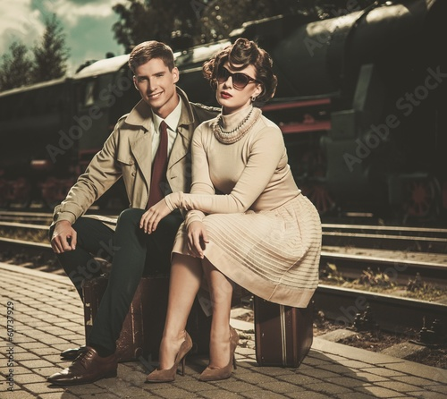 Poster Artist KB Beautiful vintage style couple sitting on suitcases
