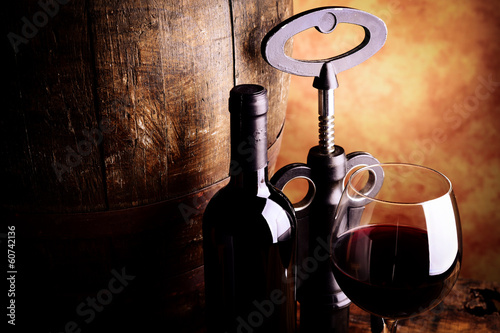 Red wine glass bottle barrel and corkscrew on wooden table Fine wine tasting concept Italian wine taste concept