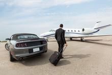 Businessman Standing By Car An...