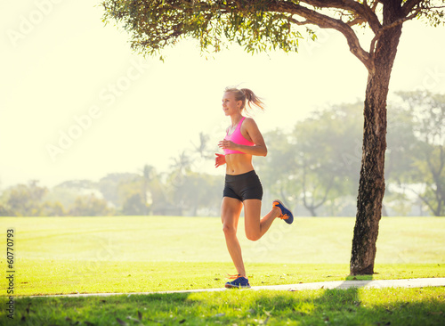 Fotografie, Obraz  Young woman jogging running outdoors