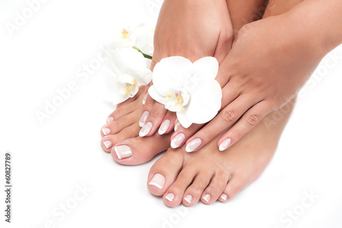 Spoed Foto op Canvas Pedicure Beautiful woman's hands and legs