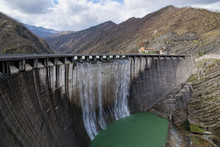 Dam With Overflow In Autumn