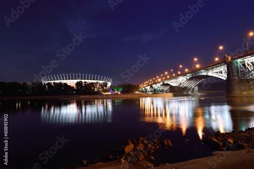 Poniatowski Bridge and National Stadium in Warsaw by night.