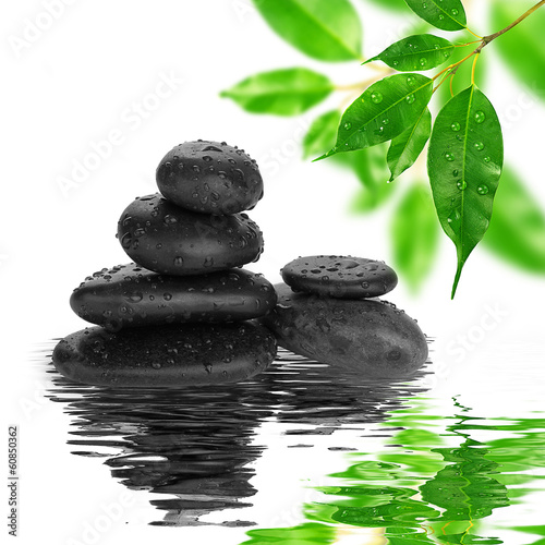 Photo  spa Background -  black stones and bamboo on water