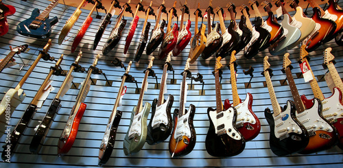 Spoed Foto op Canvas Muziekwinkel Guitars For Sale