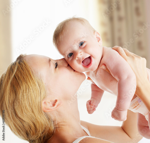 Mother with baby at home Poster