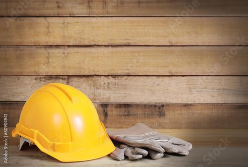 Fototapeta Yellow hardhat and leather gloves obraz na płótnie