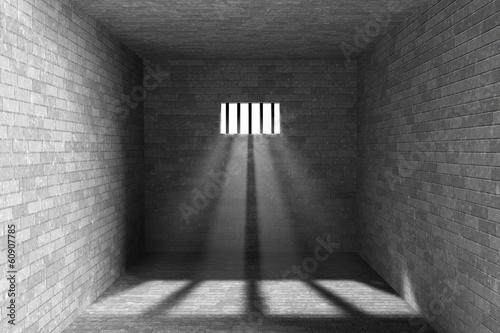 Fotografie, Obraz  Interiér vězení s světlo, které svítí skrz zamřížovaným oknem