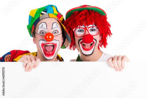 Leinwand Poster clowns mit hinweisschild