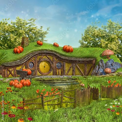 Zaczarowany domek na łące z kwiatami - 60936135