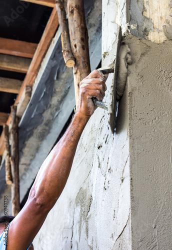 Fototapeta Plastering the poles of the Craftsman house of arms reach obraz na płótnie