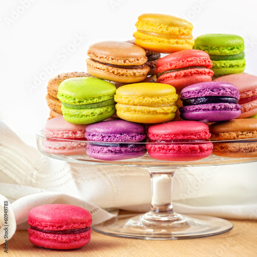 Poster Macarons french colorful macarons in a glass cake stand