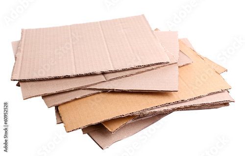 Stack of cardboard for recycling isolated on white Fotobehang