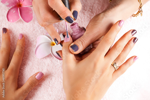 Fotografie, Obraz  Woman receiving a manicure