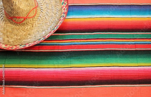 Canvas Prints Mexico Mexican poncho sombrero poncho with sombrero cinco de mayo background mexico fiesta copy space pattern stripes copy space serape blanket stock photo, stock photograph, image, picture,