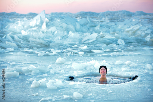 Poster Winter sports Winter swimming. Man in an ice-hole