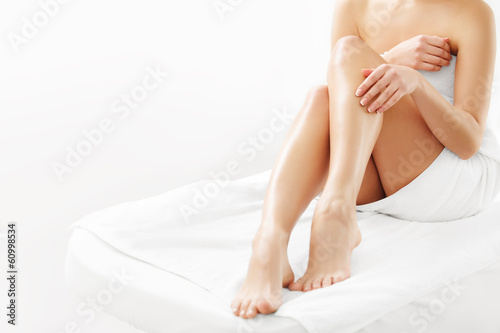 Leinwand Poster Long Woman Legs isolated on white