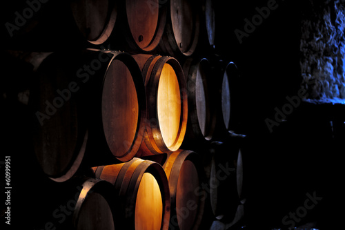 Barrel of wine in winery. Fototapet
