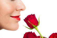 Close-up Woman Smelling A Rose
