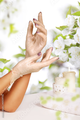 Woman hands in paraffin. Fototapet