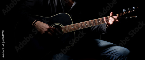 Obraz Young musician playing acoustic guitar and singing, - fototapety do salonu