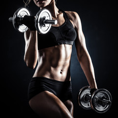 Fototapeta Do klubu fitness / siłowni Fitness with dumbbells