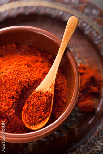 red ground paprika spice in bowl Fototapeta