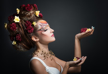 Portrait Of A Woman In Art Make-up And Hair Style With Flowers