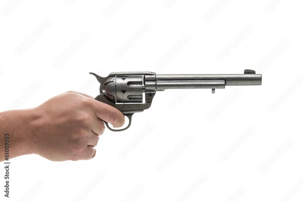 Fototapeta Men hand with revolver pistol isolated on a white background