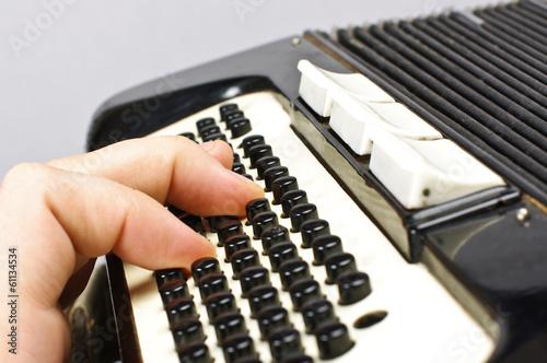 Fotografija  Male hand playing accordion