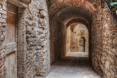 Photo Stands Narrow alley narrow alley in Todi, Umbria , Italy