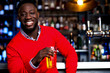 canvas print picture - African guy posing with chilled beer