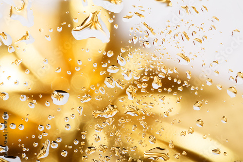 golden abstract background with water drops