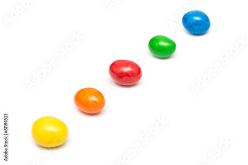 Fotografiet Colorful Row Of Coated Chocolate Candy Close Up Isolated
