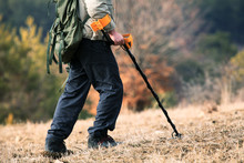 Man Searching In The Field With Metal Detector, Treasure Hunt Background