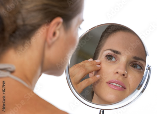 Obraz Young woman looking in mirror - fototapety do salonu