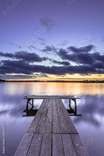 Purple Colored Sunset over Tranquil Lake with Wooden Jetty Fototapeta