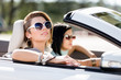 Close up of girls wearing sunglasses in the auto