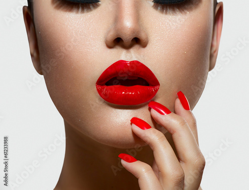 Foto auf Leinwand Fashion Lips Red Sexy Lips and Nails closeup. Manicure and Makeup