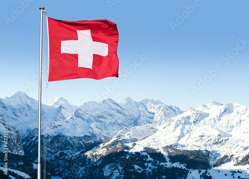 Fotografie, Obraz Swiss Flag Flying Over Alpine Scenery