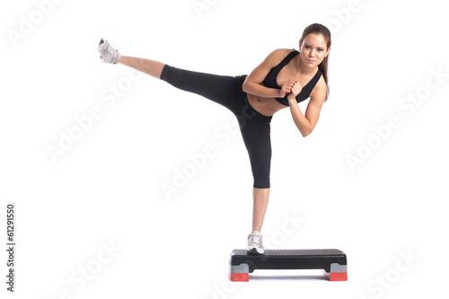 Fotografie, Obraz  Young slender brunette exercising on stepper